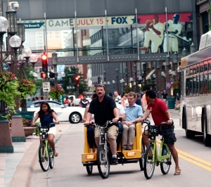 Let us do the pedaling, that's the credo of the pedi-cab drivers in downtown Minneapolis. Pedi-cabs are allowed to travel on Nicollet Mall - sharing the pavement with bicyclists, buses and pedestrians. The weather was fine for pedi-cab riding on July 4.
