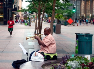 A man plays the trumpet on Nicollet Mall.